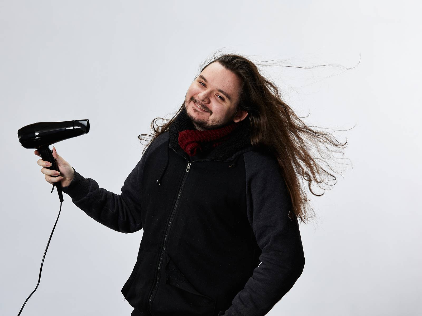 Calin blowdrying his long, flowing locks of hair