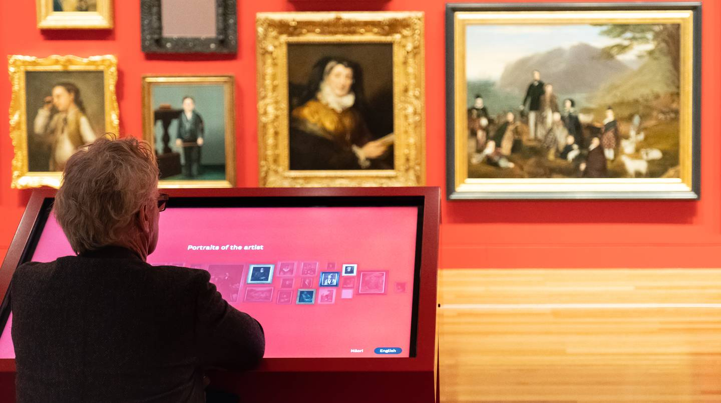 A Te Papa visitor browsing portraits using the project